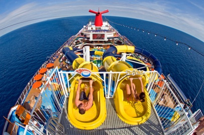 Guests slide down two massive corkscrew waterslides featured within the Carnival Dream's expansive WaterWorks attraction, the most elaborate water park at sea. FOR EDITORIAL USE ONLY (Photo by Andy Newman/Carnival Cruise Lines/HO